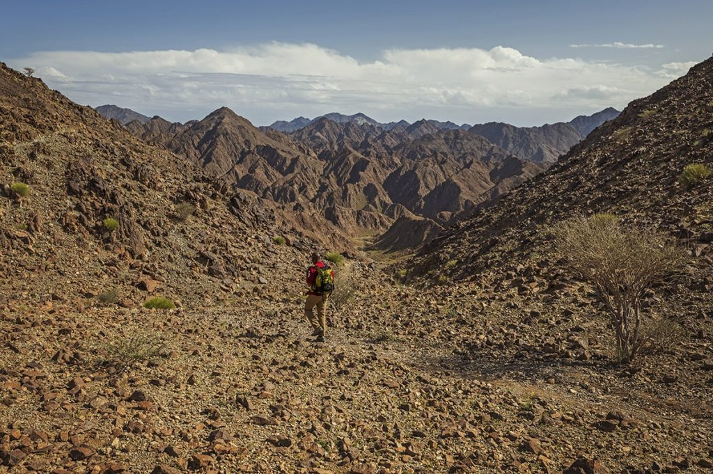 a man hiking in shawka area united arab emirates