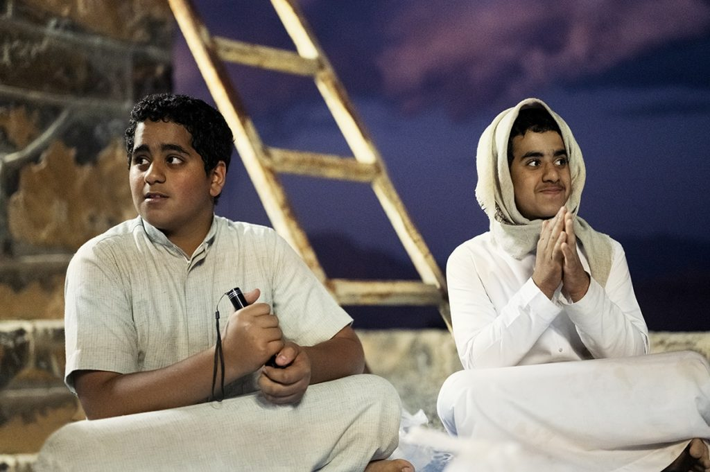 emirati children sitting at the house of the mountain village