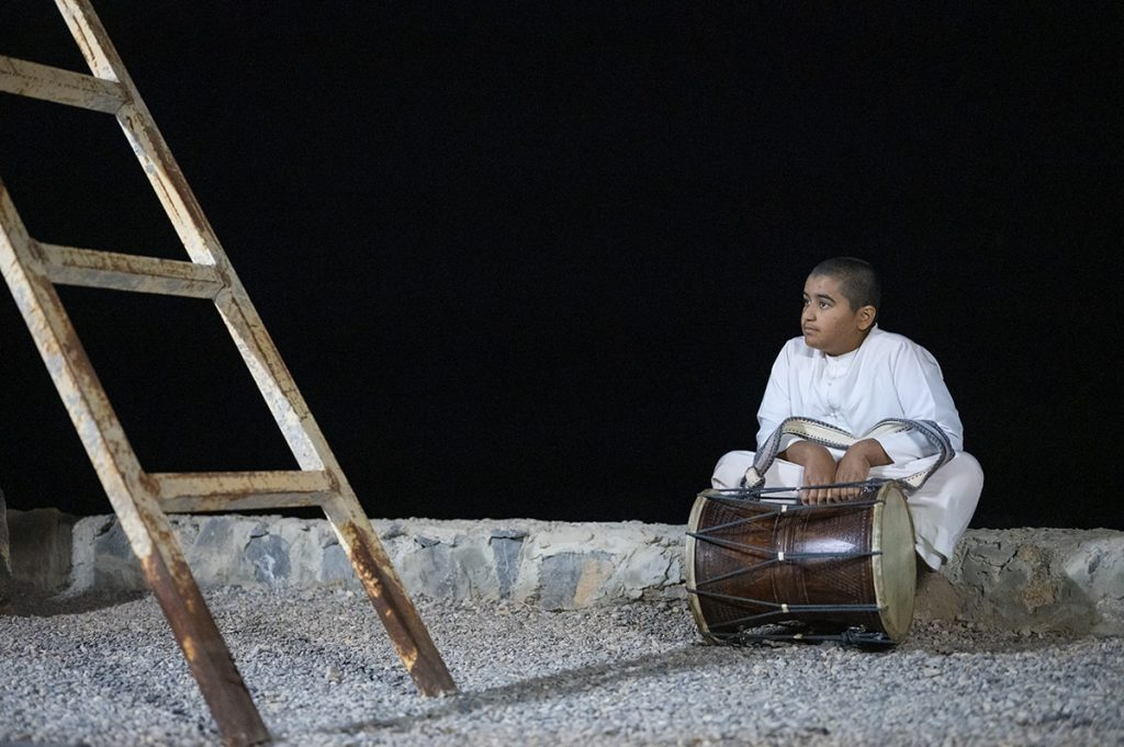 emirati boy sitting with a drum