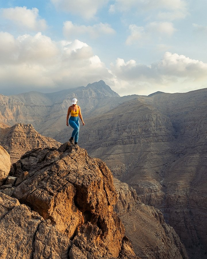 woman on the rock in uae mountains
