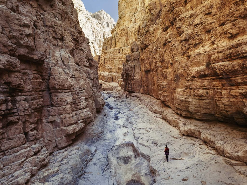 woman walking in the gorge in ras alkhaimah uae