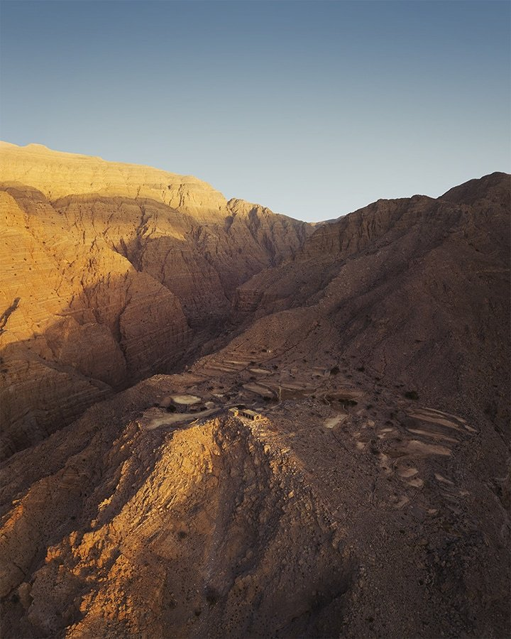 aerial view of the mountain village at sunset in wadi naqab uae